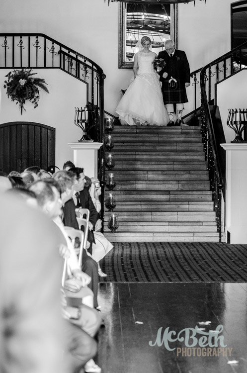 bride and dad walking down the aisle