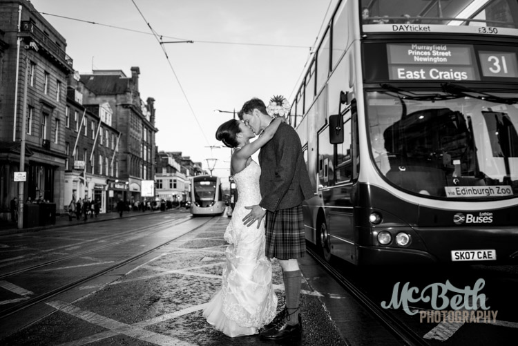 bride and groom on Edinburgh's princes street