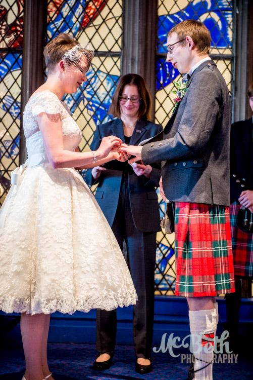 bride and groom exchange rings.